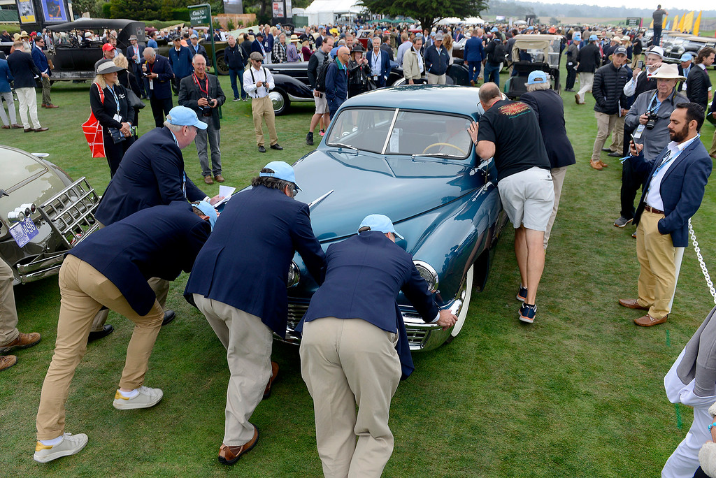 . A 1948 Tucker belonging to director Francis Ford Coppola needed a push at the Pebble Beach Concours d\'Elegance on Sunday, August 26, 2018.  (Vern Fisher - Monterey Herald)