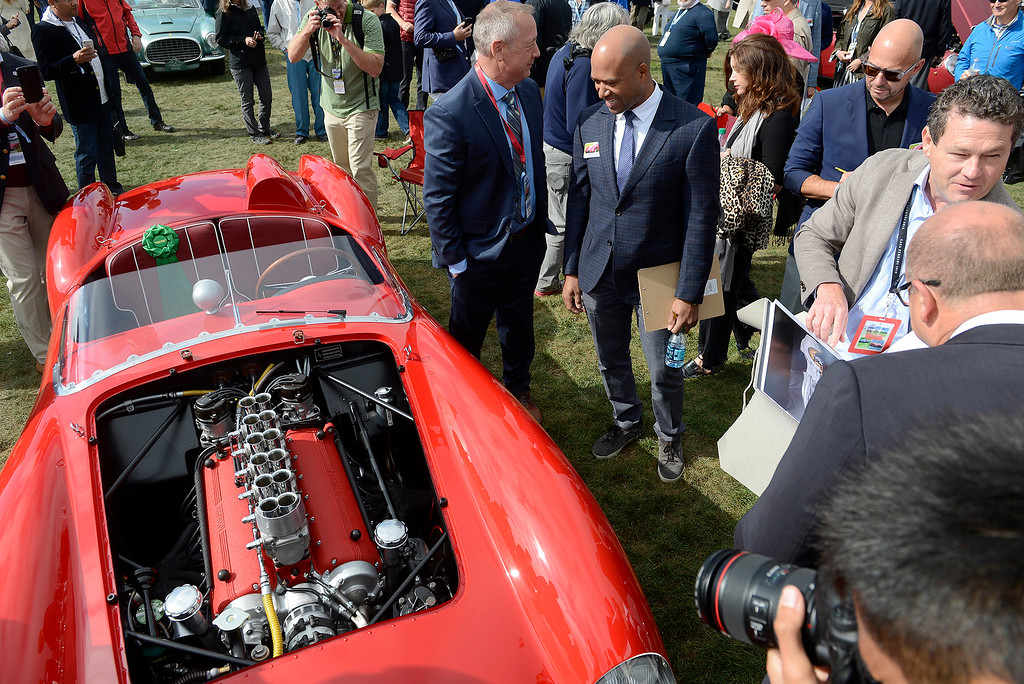 . Judges look over a 1958 Ferrari 250 Testa Rossa Spyder at the Pebble Beach Concours d\'Elegance on Sunday, August 26, 2018.  (Vern Fisher - Monterey Herald)