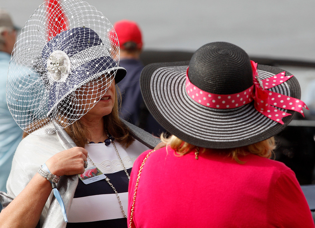 . Teresa Disiere and Shelly Carter wearing big hats at the Pebble Beach Concours d\'Elegance on Sunday, August 26, 2018.  (Vern Fisher - Monterey Herald)