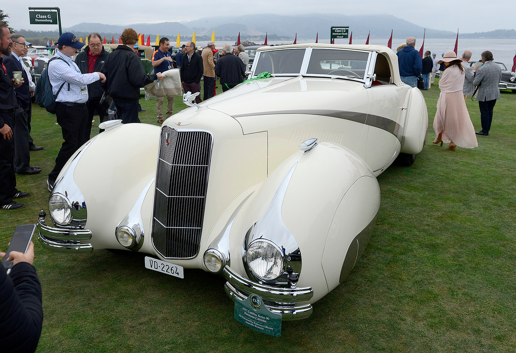 . Jim Patterson shows his 1937 Cadillac Series 90 Hartmann Cabriolet at the Pebble Beach Golf Links during the Pebble Beach Concours d\'Elegance on Sunday, August 26, 2018.  (Vern Fisher - Monterey Herald)