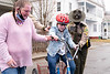 Sierra Fletcher gets a little help from her Mom, Rita and Vermont State Troopers as she gets rolling on her new trike, donated by the police-based charity, Pedal Thru Youth.