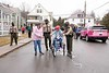 Sierra Fletcher ges a little help from Vermont State Trooper, Marina Pacilio, and encouragement from her Mom and several others, as she takes the first spin on her new trike donated by the police-based charity, Pedal Thru Youth, out of Chicopee, MA.