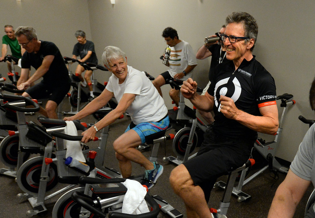 . BOULDER, CO - SEPTEMBER 12: Former Olympic and professional cyclist, Davis Phinney, right, enjoys the music in the class during the Pedaling for Parkinson�s Workout of the week.  (Photo by Cliff Grassmick/Staff Photographer)