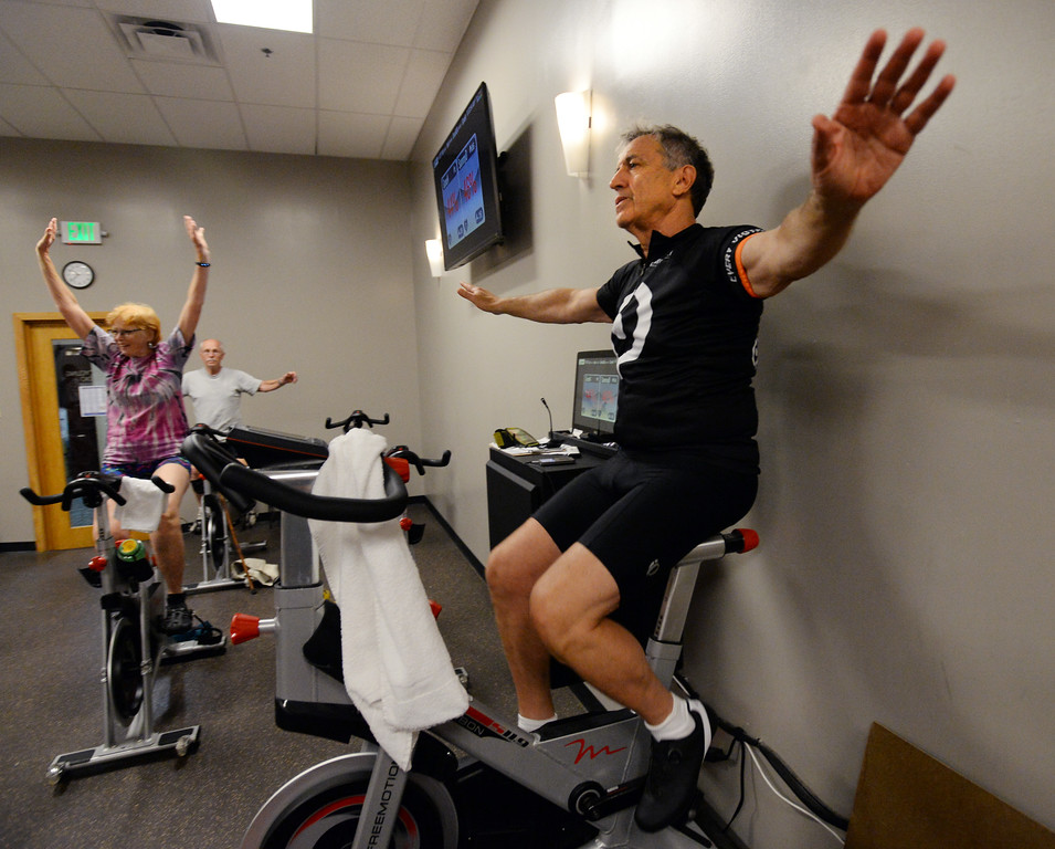 . BOULDER, CO - SEPTEMBER 12:  Marc Sotkin, right, leads the class during the Pedaling for Parkinson�s Workout of the week.  (Photo by Cliff Grassmick/Staff Photographer)
