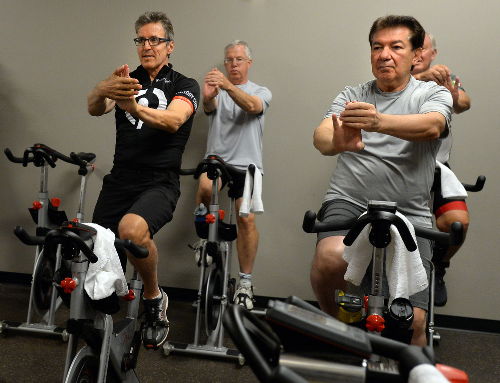 . BOULDER, CO - SEPTEMBER 12: Former Olympic and professional cyclist, Davis Phinney, left, and Mike Mansour, work their hands and arms during the Pedaling for Parkinson�s Workout of the week.  (Photo by Cliff Grassmick/Staff Photographer)