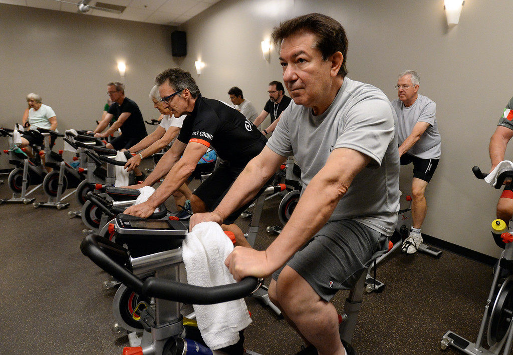 . BOULDER, CO - SEPTEMBER 12: Mike Mansour, rides in the class during the Pedaling for Parkinson�s Workout of the week.  (Photo by Cliff Grassmick/Staff Photographer)