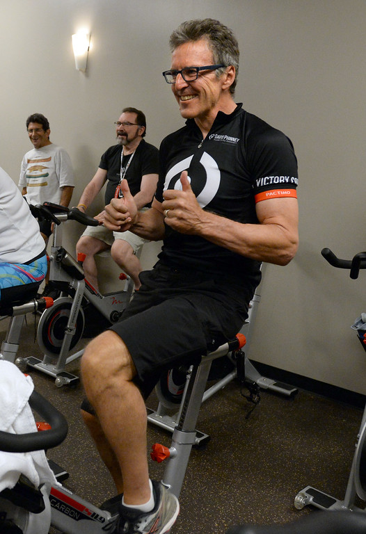 . BOULDER, CO - SEPTEMBER 12: Former Olympic and professional cyclist, Davis Phinney, enjoys the music in the class during the Pedaling for Parkinson�s Workout of the week.  (Photo by Cliff Grassmick/Staff Photographer)