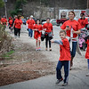 Walkers start filing in after the runners reach the finish line of the Pediatric Care 5k. SUN/Caley McGuane
