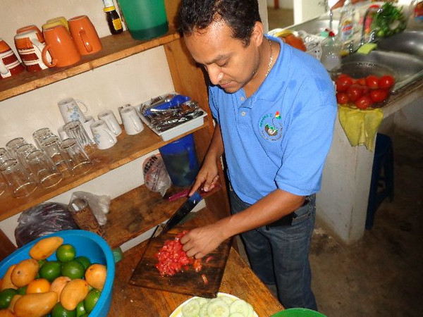 Jesus Ramirez, Director f the Pej Pem Center, dices tomatoes grown in Pej Pem's vegetable garden. These will no doubt find their way into a tasty salsa to be enjoyed at a communal meal by Center staff and program participants.