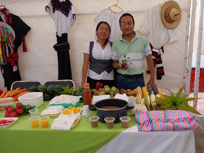 Jesus Ramirez, Director of the Pej Pem center, talks with one of many exhibitors showcasing organic foods produced with sustainable agriculture practices.