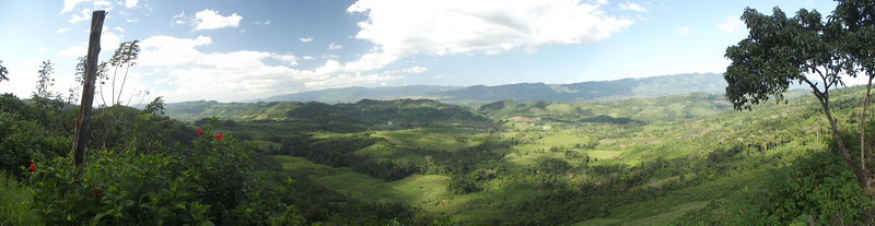 This panoramic view of a valley in Chiapas reveals the extent of deforestation. Note that the tall trees of the forest canopy only cover hilltops; trees on the hillsides and valley floor have been cut down for firewood or lumber and the land used for  producing crops or grazing livestock. <i>[To view a larger image, hover the mouse over the right edge of the photo.]</i>