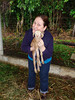 Linda gives a snuggle to a two-day old baby goat. Pej Pem staff show farmers how to raise small livestock.