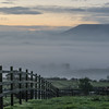 Pendle Hill rising out of the early mist in the valley near Chatburn