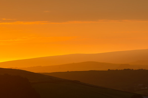 Sunrise from the moor above Sabden, looking over Churn Clough towards Brierfield.  The light was looking promising as the sunrise approached the horizon then...!  Amazing morning.  Beautiful.