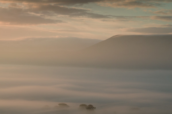 Dawn.  Taken from Wadding Fell in October as the early morning sun begins colour the sky and reflect on the mist in the Ribble Valley.