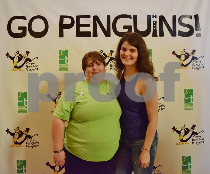 "Children's Community Theatre's Penguin Project artist Kayla Craig (left) and her mentor Samantha Hepker, both of Sycamore, pose for a photo during the premiere of ""Go Penguins!,"" a documentary about the Penguin Project's 2013 show, ""The Little Mermaid."" The documentary debuted Sunday at the Egyptian Theatre in DeKalb."