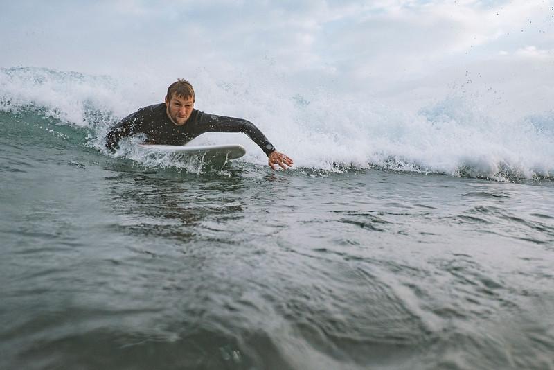 Lasse getting some action in the north beach break in Peniche