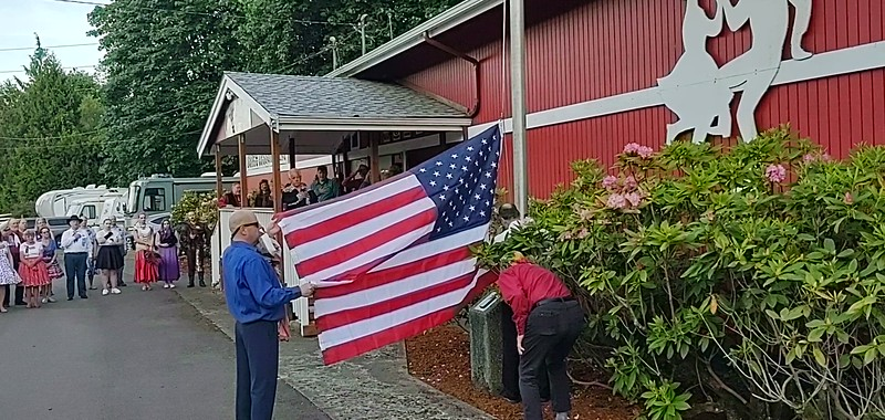 """""""New"""" Old Glory goes up the flagpole."""
