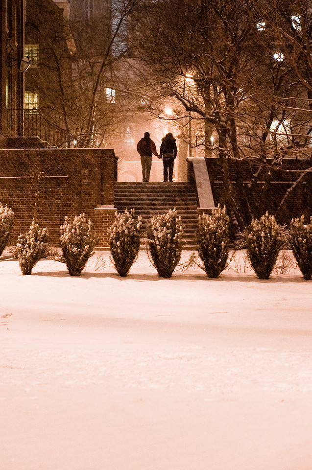 A pair of students walk hand in hand through the West quad early in the evening of Friday, Feb. 5, when only a few inches of snow had fallen.