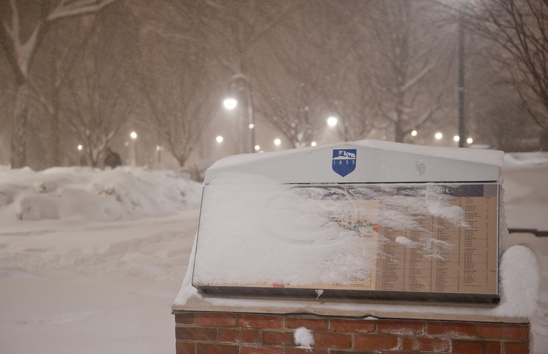 """A campus map kiosk is coated with blowing and drifting snow early in the morning of Saturday, Feb. 6. The snowfall accumulated up to 14"""" inches around University Park, with other commonwealth campuses receiving as much as ______"""