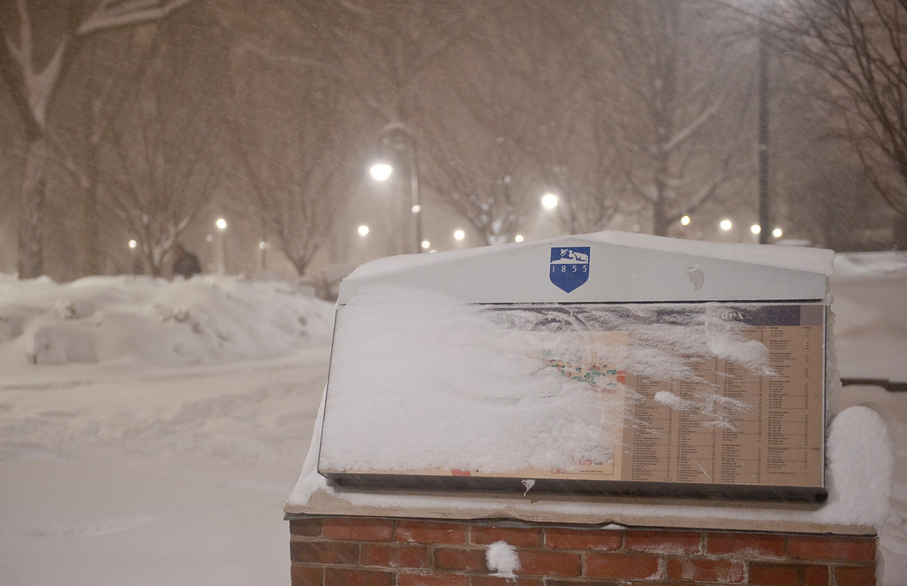 "A campus map kiosk is coated with blowing and drifting snow early in the morning of Saturday, Feb. 6. The snowfall accumulated up to 14"" inches around University Park, with other commonwealth campuses receiving as much as ______"