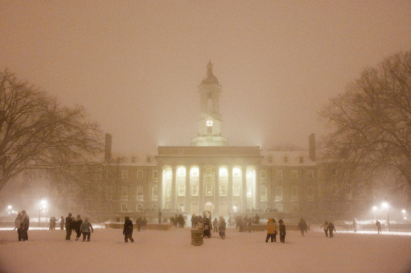 """At least a hundred Penn State students gathered on the Old Main lawn at midnight during the Feb. 5-6 snowstorm for a spontaneous, text-message-driven THON-wide snowball battle. Other such groups had formed on the HUB lawn and in the West Halls quad throughout the wintery evening which brought at least 14"""" of snow to the State College area."""