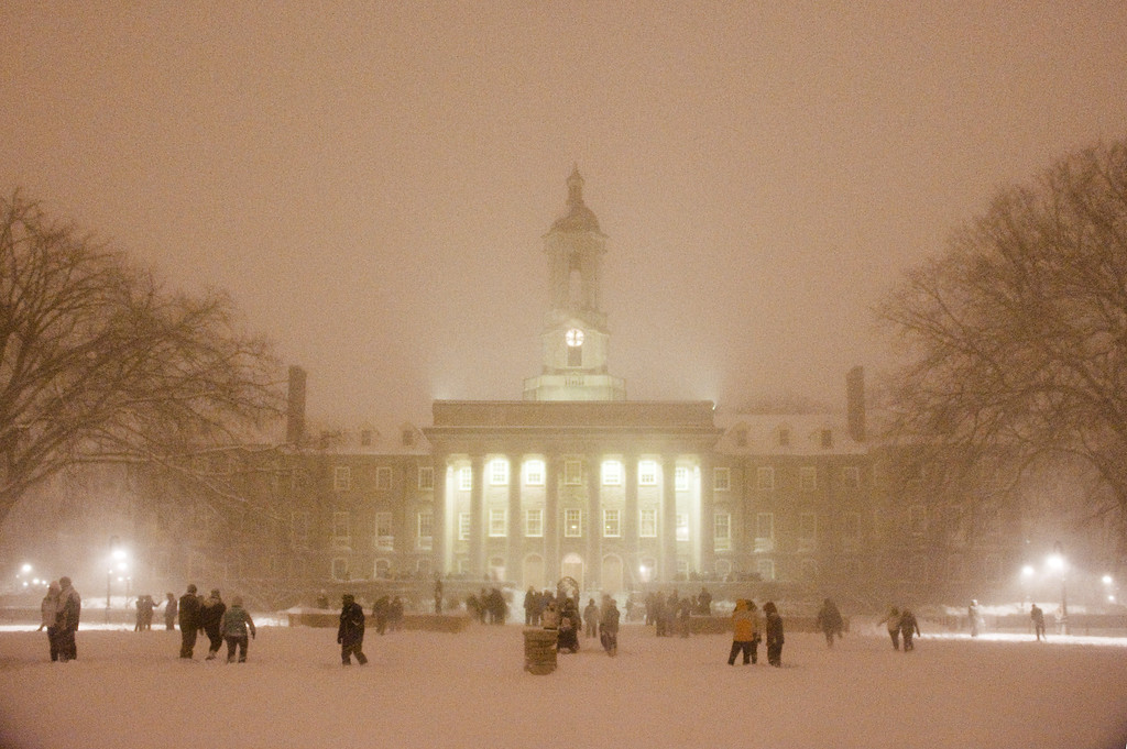 "At least a hundred Penn State students gathered on the Old Main lawn at midnight during the Feb. 5-6 snowstorm for a spontaneous, text-message-driven THON-wide snowball battle. Other such groups had formed on the HUB lawn and in the West Halls quad throughout the wintery evening which brought at least 14"" of snow to the State College area."