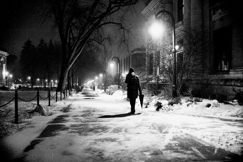 A student treks down Pattee Mall near Carnegie Building late on Thursday, Feb. 25 as more snow threatened Happy Valley from a large storm system covering most of the mid-Atlantic states into New English from Thursday, Feb. 25 into Friday, Feb. 26. The snow storm arrived in Central PA with  high winds and drifting instead heavy snow. Photo by Andy Colwell