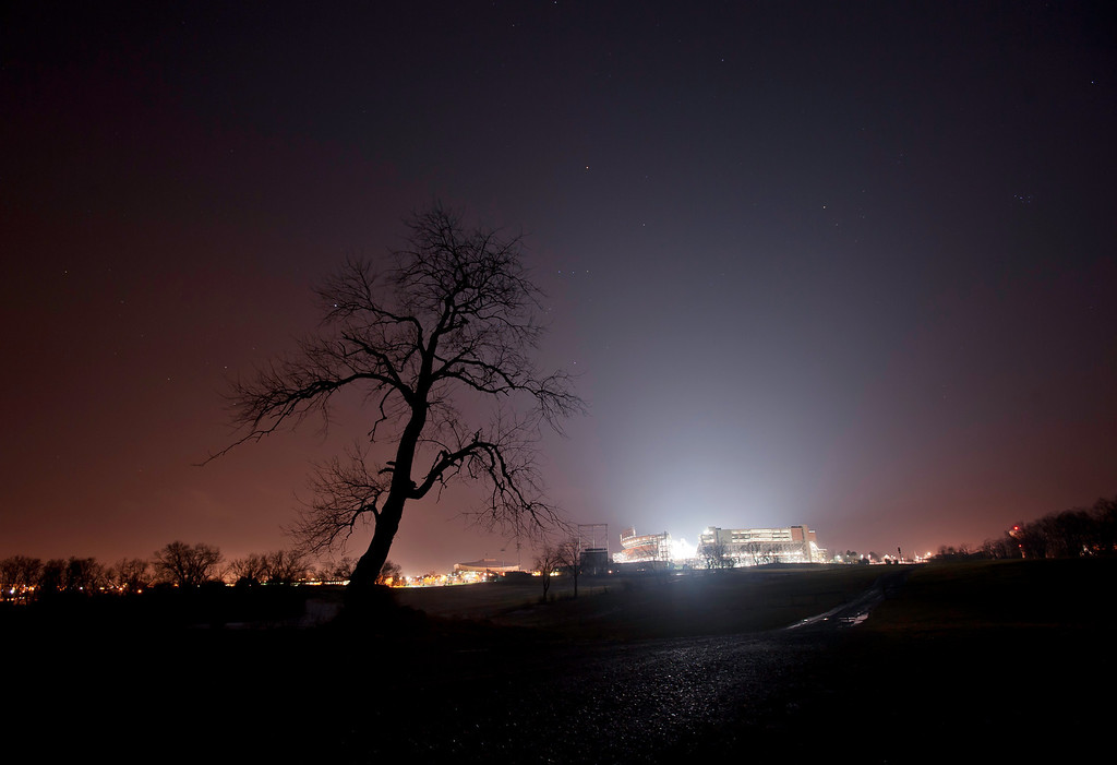 Beaver Stadium glows early in the morning of Monday, Jan. 23, 2012, as Penn State mourned the death of its former head football coach Joe Paterno. Photo by Andy Colwell