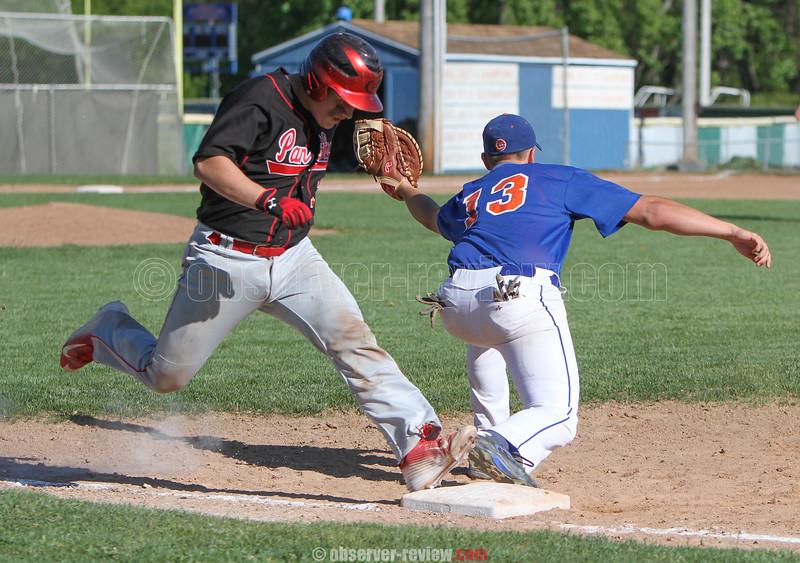 Action during the Penn Yan vs. Geneva baseball game, May 14, 2015.