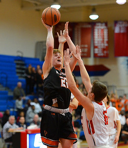 Joey Monaghan (22) added 11 points to the Falcon cause.