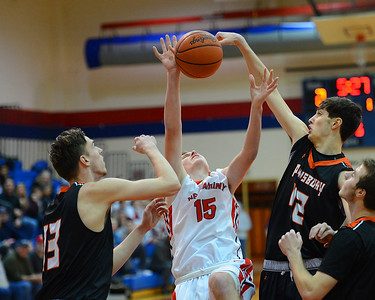 Pennsbury seniors Mark Flagg, 42, right, and Billy Warren (13) defend against Chris Arcidiacono (15) in Falcons' win over the Skins Jan. 24 in Langhorne, Pa. (John Gleeson – 21st-Century Media)