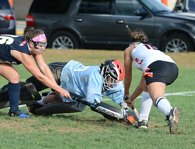CR South goalkeeper Aspen Handel (00) dives for ball off stick of Pennsbury's Olivia Mauro (15) Oct. 10 on the Falcons' home field. (John Gleeson – 21st-Century Media)