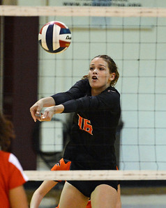 Shelby Hastings (16) digs out service.