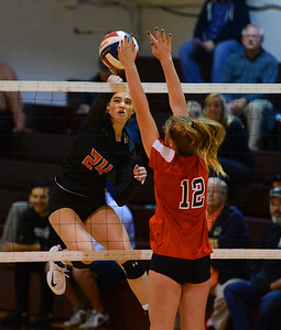 Elley Torres (24) records a kill for the Falcons.