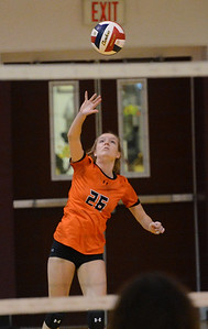 Heather Linker (26) serves for the Falcons.