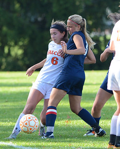 Lizzy Kirk (6) and Julie Rebh (3) vie for possession.
