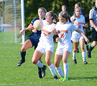 Hope Drewes (9) keeps the ball from Paige Mikula (10).