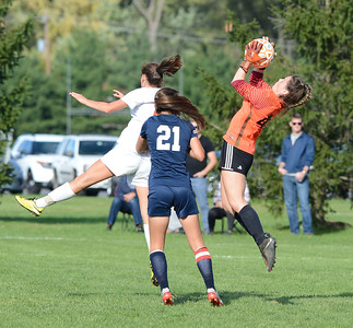 CR South goalie Emily Helmich goes up for save in font of Evie Ciaccia (24).