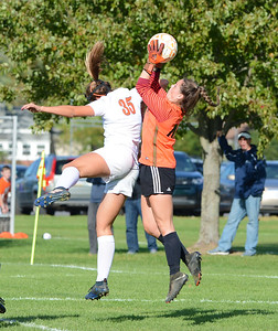 Emily Helmich beats Rosie Bostian (35) to the ball.