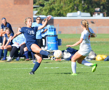 Paige Mikula (10) boots ball by Riley Young (8).