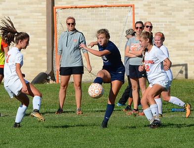 Paige Mikula (10) sends the ball past Christine Cataldo-Smith (21) and Gabby Zalot (2).