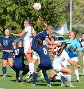 Hope Drewes (9) battles Julie Rebh (3) in front of Falcons' goal.