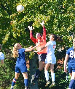 Emily Hemlich (00) goes up for shot on goal.