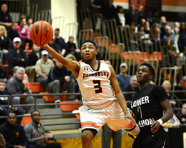 Pennsbury senior Addison Howard (3) drives by Aces defender Steve Payne (1) in 2017 District 1 boys basketball playoff battle with Lower Merion Feb. 28, 2017 at PHS West HS gym. (John Gleeson – 21st-Century Media)