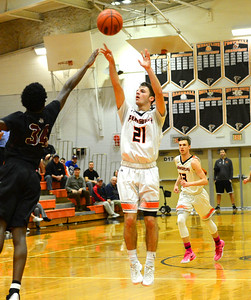 Tyler Sessa-Reeves (21) scores on a jumper.