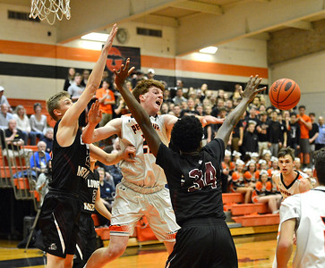 Joey Monaghan (22) battles Terrell Jones(34) for rebound.
