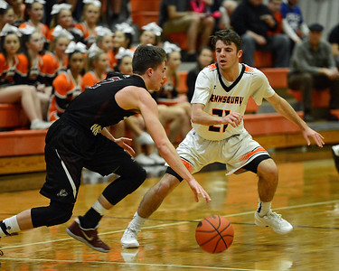 Tyler Sessa-Reeves (21) closely guards Noah Fennell (2).
