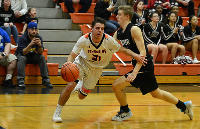 Tyler Sessa-Reeves beats Jack Forrest (21) to the baseline.