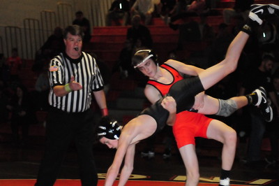 Pennsbury sophomore Ryan McGurrin (standing) pinned Truman 106-pounder Dylan Culver in 3:02 to go to 8-2 on the season.